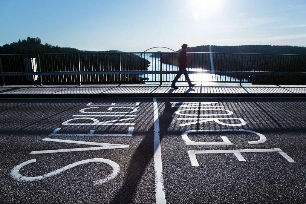 person walking on the bridge
